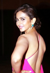 Rakul-preet-pink-backless-stills-at-pandaga-chesko-Audio-Launch-13